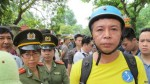 FILE - Anti-China protester surrounded by police in Hanoi, Vietnam, May 18, 2014 (Marianne Brown/VOA)
